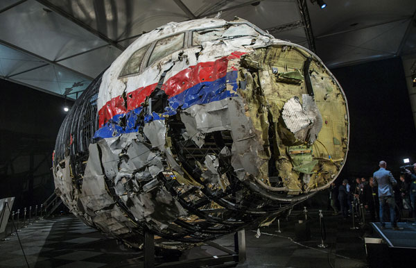 Four suspects to be charged with murder in 2014 downing of flight MH17