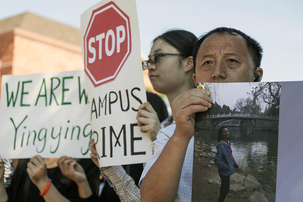 Ex-girlfriend of man accused of killing Chinese scholar testifies