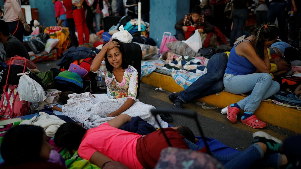 About 200 mostly Venezuelan migrants stuck at Chile-Peru border