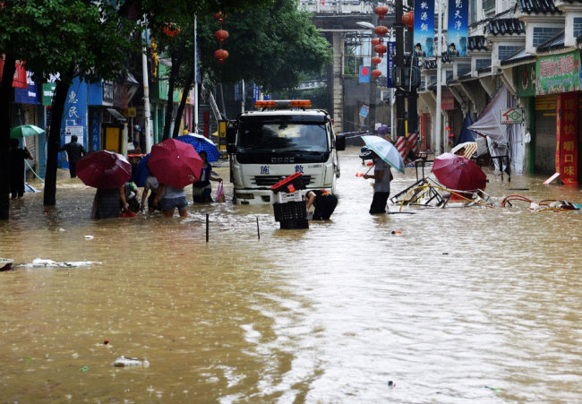 2 dead, 4 missing as rainstorms hit southwest China