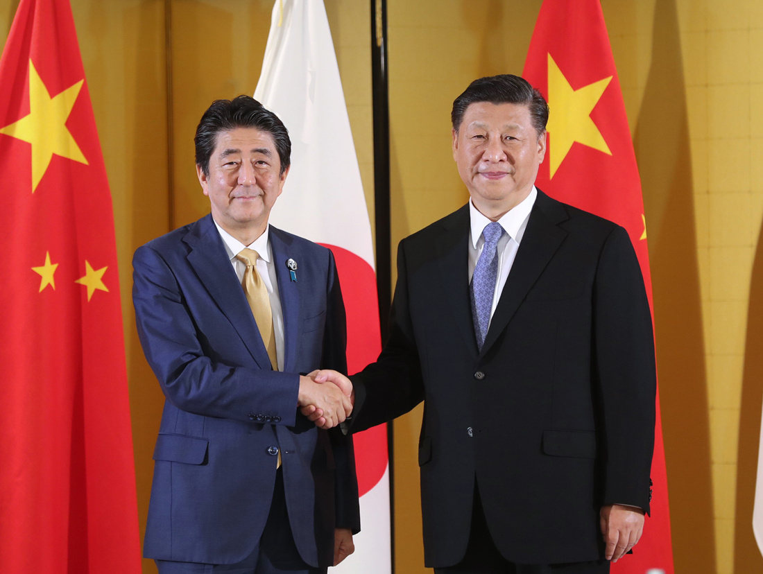 Xi, Abe agree to build China-Japan relations in accordance with needs of new era