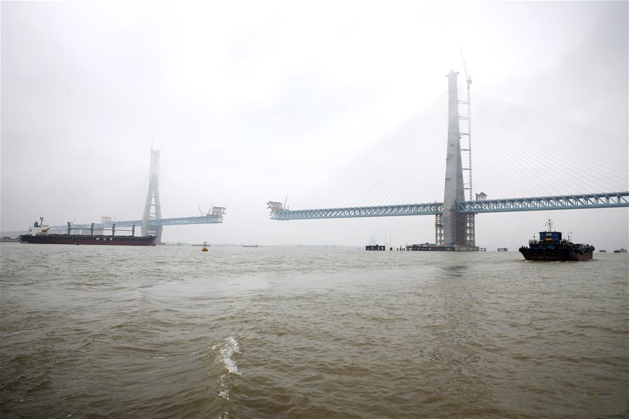 Main tower of world's largest road-rail cable-stayed bridge built