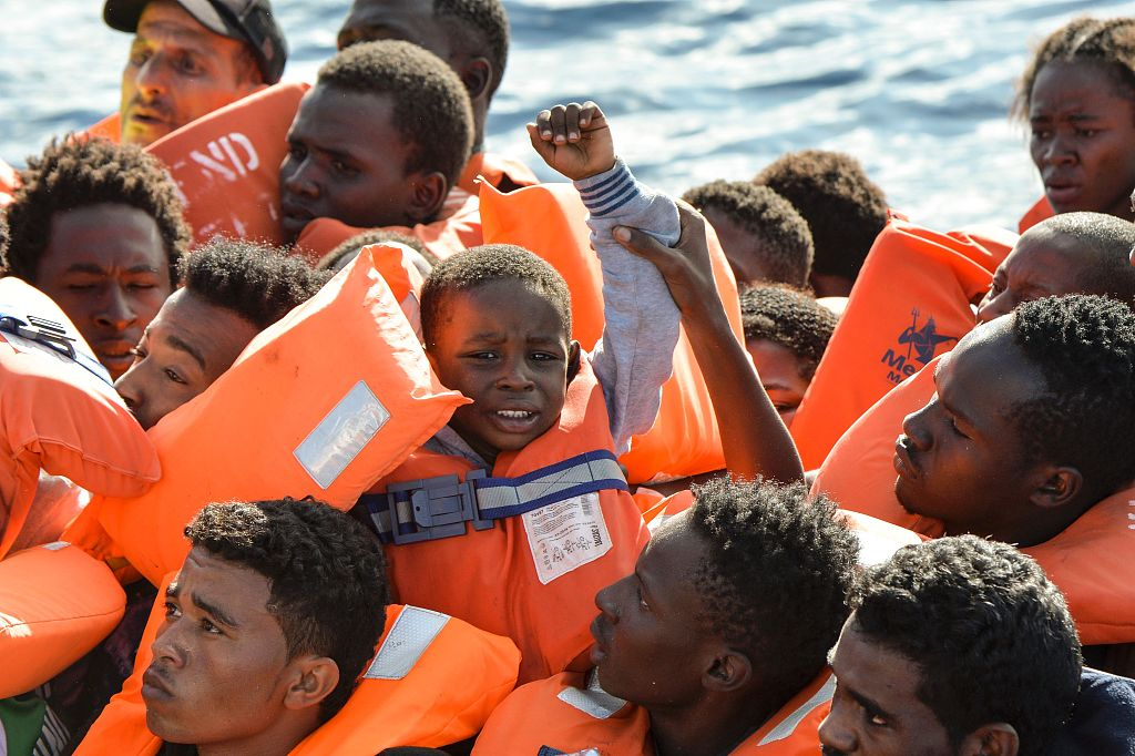Migrants step off German aid ship after captain defies Italy