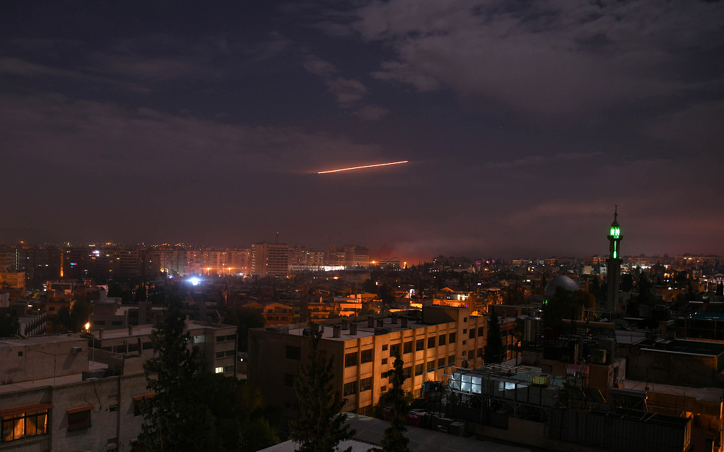 Syria's air defenses respond to Israeli missile attack in Damascus, Homs