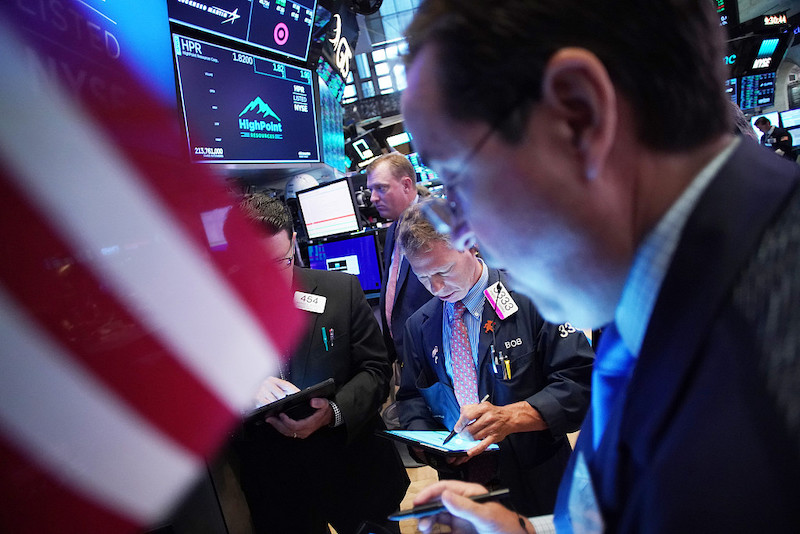 Wall Street hits record high amid positive signs in trade