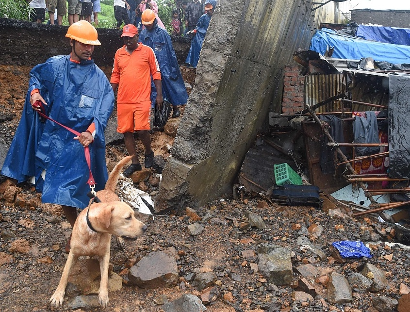 Wall collapse kills 15 as monsoon causes chaos in Mumbai