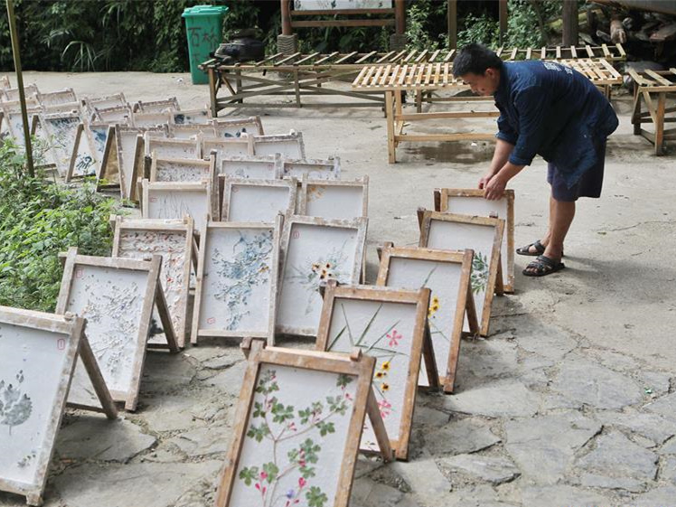 Traditional paper making in combination with cultural innovation in village of Guizhou