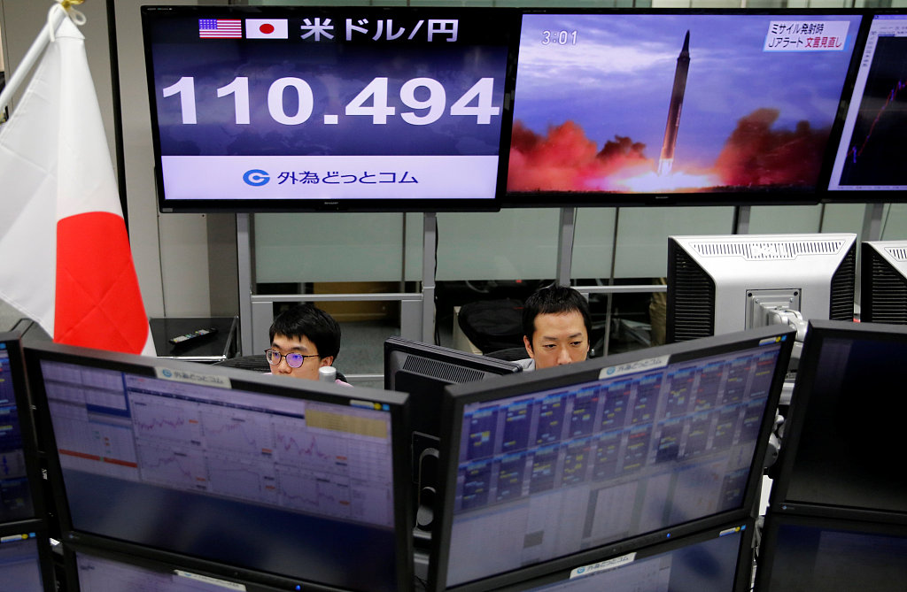 Tokyo stocks lose ground in morning as yen's rise hurts exporters