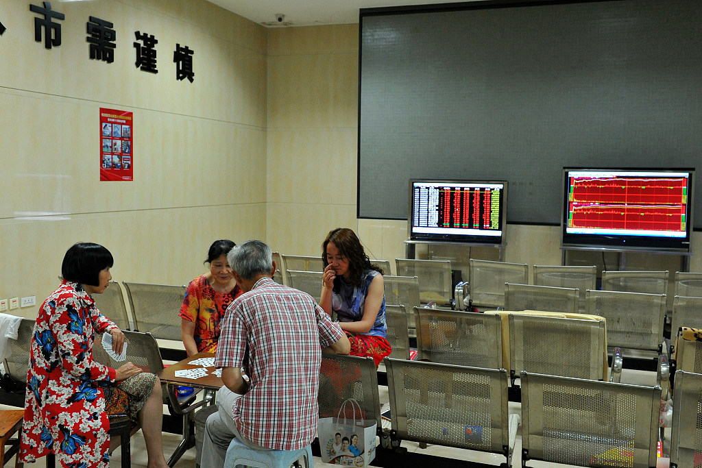 Chinese shares close lower at midday Wednesday