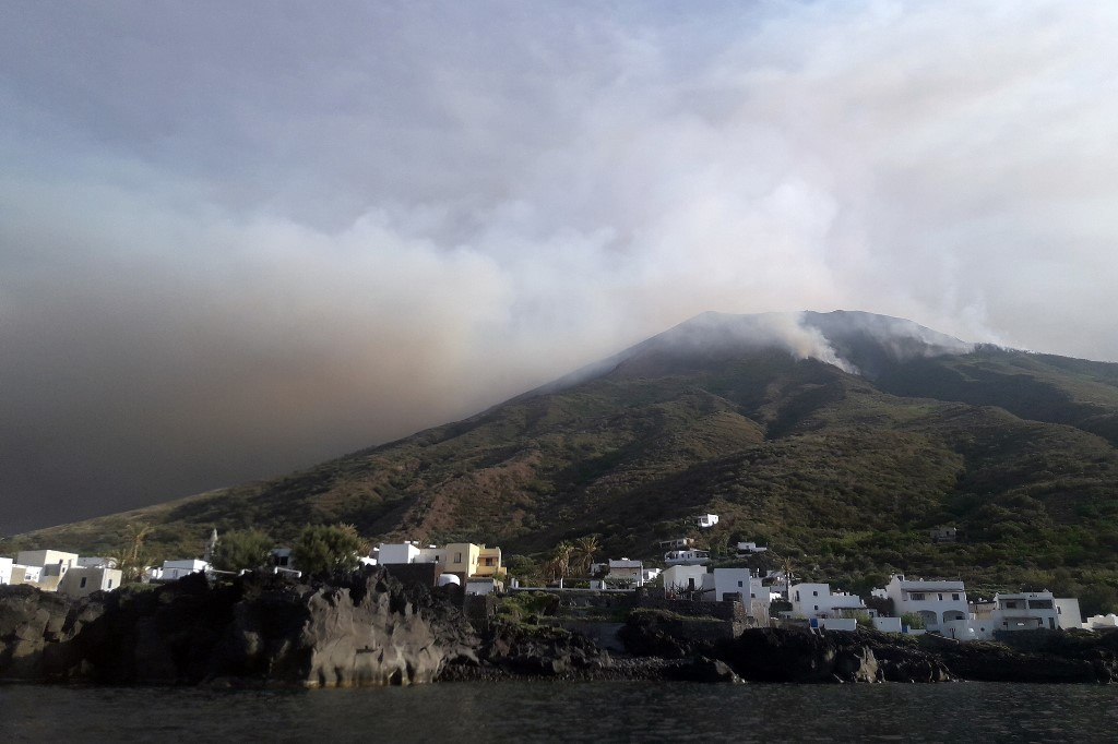 Italy firefighters attempt to put out fires after Stromboli eruption