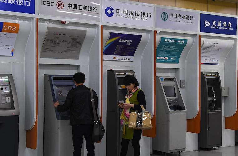 China's banking, insurance opening-up process not driven by trade war: official