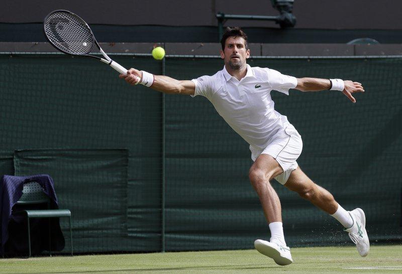 Djokovic drops set but advances at Wimbledon