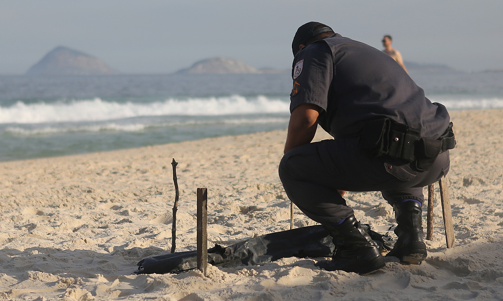 Rio police find clandestine grave with at least 12 bodies