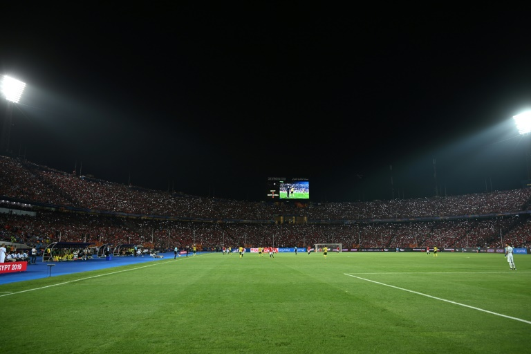 Egyptians light up stadium in tribute to fallen fans