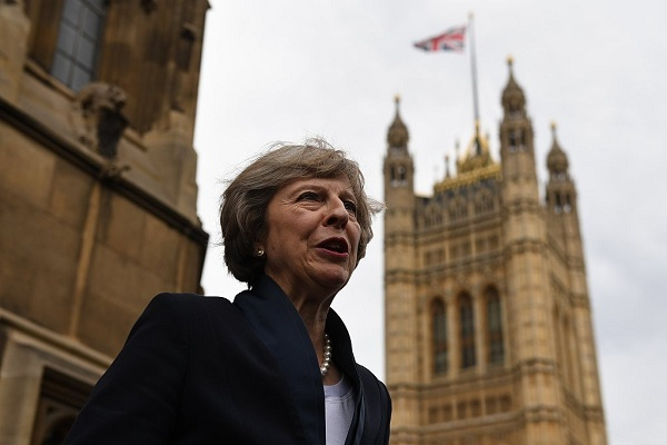 British PM says ambassador who critisized Trump has her full support