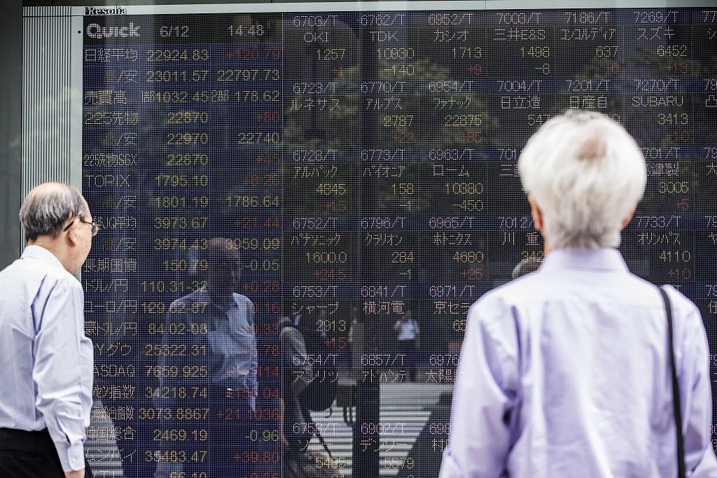 Tokyo stocks fall ahead of Powell testimony