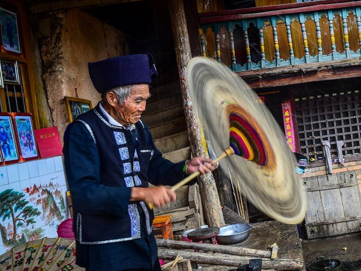 Inheritors of traditional oil-paper umbrella making in Xiangyang Village, SW China