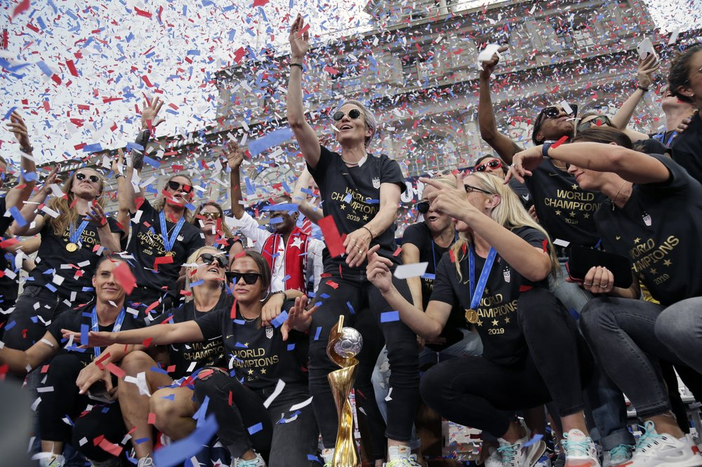 Fans cheer World Cup champs as leaders on and off the field
